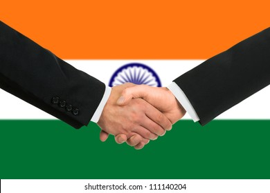 The Indian flag and business handshake