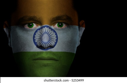 Indian flag painted/projected onto a man's face.