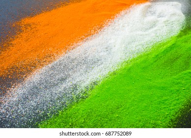 Indian flag tricolors splashed on a dark background. Indian Independence Day background.