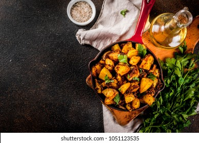 Indian food, Bombay Potatoes on dark rusty background copy space top view