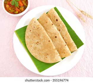Indian food chapati or Indian flat bread is a traditional, popular and vegetarian food made from wheat flour dough.