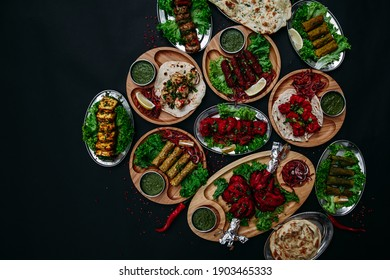 Indian food cooked in tandoor on dark background