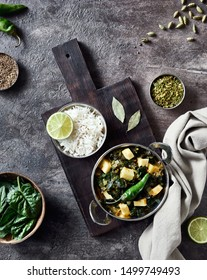 Indian food palak paneer with spinach, cottage cheese and spices on grunge background
