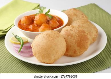Indian food - Puri Bhaji. North India. Puri is a deep fried bread made from whole wheat flour & Served with Potato curry , bhaji or alu ki sabji.or Potato curry or dum alu curry