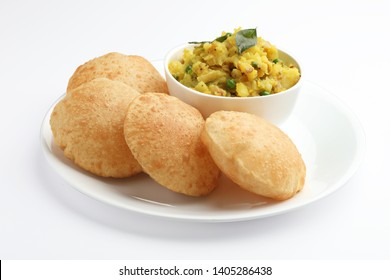 Indian food Puri & Potatoes served in a ceramic plate