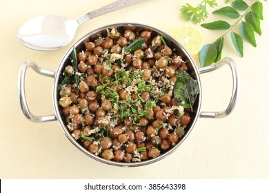 Indian food sundal or brown chickpea curry.
