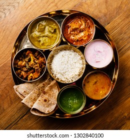 Indian food Thali  Indian-style meal with chicken meat on wooden table