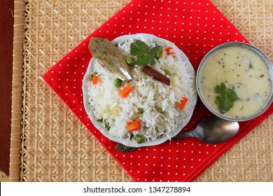 Indian food vegetable traditional Cooked pulav rice or Basmati Rice biryani with kadhi