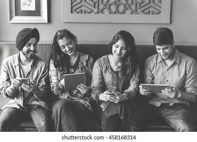 Indian Friends Hangout Indoors Technology Concept