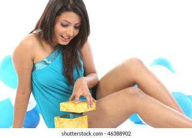 indian girl with balloons and present box