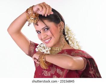 Indian girl with beautiful smile in red sari