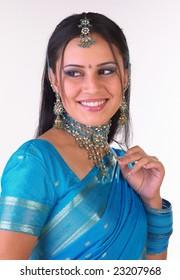 Indian girl with blue sari feeling  her jewelery