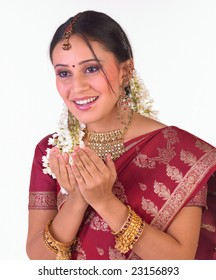 Indian girl holding both her hands with nice expression