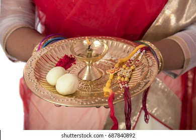 Indian girl performing worship, portrait of a beautiful young girl with pooja thali isolated on white background