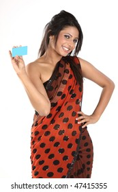 Indian girl in sari holding blue blank credit card
