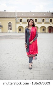 An Indian girl stands on the street of the city of Ivano-Frankivsk. Girl in traditional Indian clothing, salwar kameez.