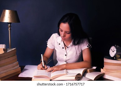 Indian girl studying, preparing for competition late night.