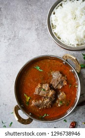 Indian Goat lamb curry served with rice, top down view