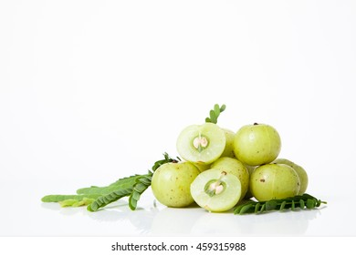 Indian gooseberry or amla fruit with leaf isolated on white background