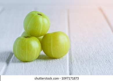 Indian gooseberry on white wooden table
