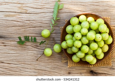 Indian gooseberry on a wooden floor