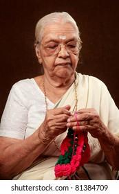 An Indian grandmother crocheting