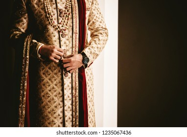 Indian groom getting his sherwani