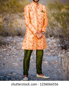 Indian groom showing wedding sherwani style