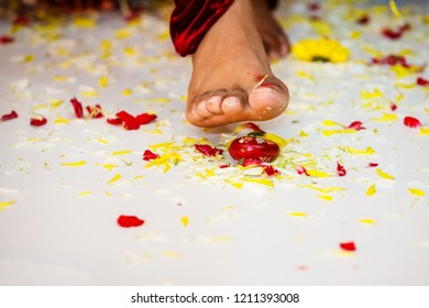 Indian groom stepping on betel nut