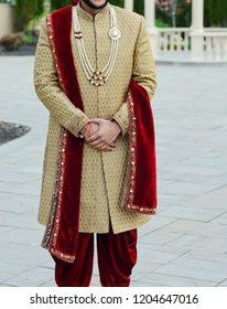 Indian groom wearing wedding sharwani dress