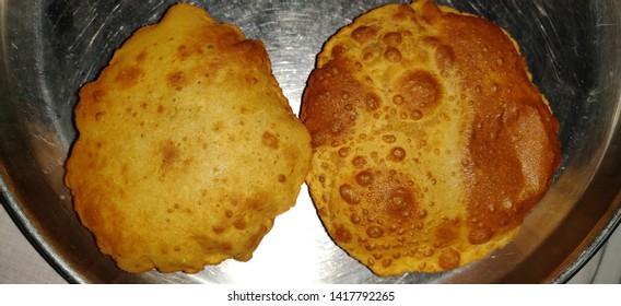 Indian gujarati food puri or poori. Homemade Indian Potato Poori or Puri . Khasta kachori,bedmi poori,stuffed daal poori, Bedvi poori.
