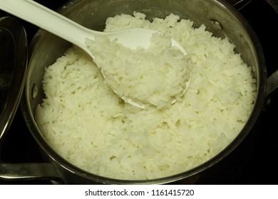 indian gujarati  food rice cooking on kitchen stove