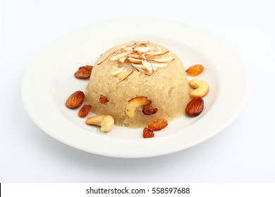 indian gujrati or maharahashtrian or south indian sweet dish  SUJI Halwa or sheera or KESARI, famous sweet food in india, also known as halwa, served in white ceramic plate, garnished with dry fruits,