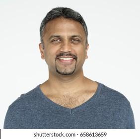 Indian guy smiling cheerful studio portrait
