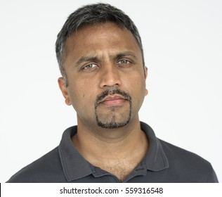 Indian guy thoughtful expression studio portrait
