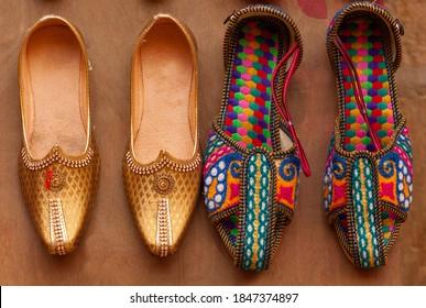 Indian handmade Punjabi Jutti and Kolhapuri Chappal - colorful womens ethnic footwear at local market in Jaisalmer, Rajasthan, India