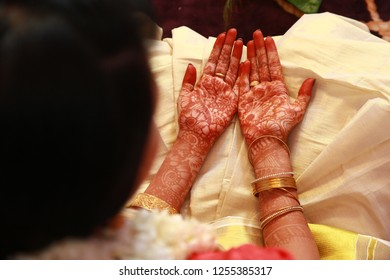 Indian bride's hands decorated with henna paste or mehndi before wedding.