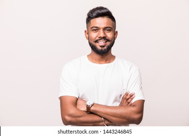 Indian handsome young man standing with hands folded against white background