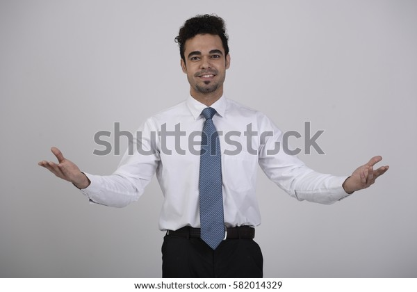 Indian happy welcoming employee with an open hands gesture