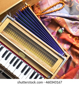 Indian harmonium, a traditional wooden keyboard instrument, close-up