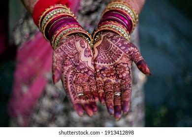 Indian Hindu bride's wedding henna mehndi hands close up