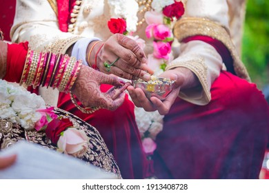 Indian Hindu couple's hands close up wedding ceremony, religious items and rituals, pooja