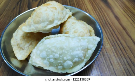 Indian Hindu festival sweet item called as Karanji served in a plate.