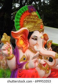 Indian Hindu God Lord Ganesha Statue made of clay and coated with ceramic colors, handmade artistic effects