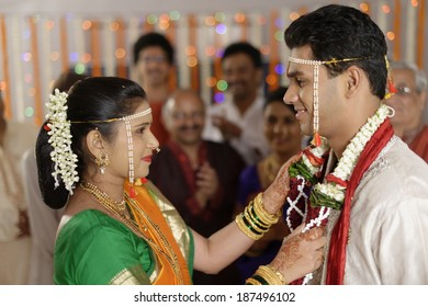 Indian Hindu ritual of exchanging garlands by bride and groom in wedding in Maharashtra.