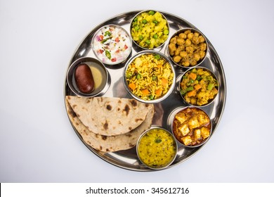 Indian or Hindu Veg Thali or Restaurant style complete Food platter for Lunch/Dinner. Closeup, selective focus