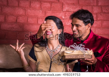 Indian Husband Surprising Wife With A Gift On Diwali Anniversary Birthday While Sitting