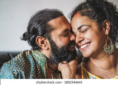 Indian husband and wife having tender moments - Portrait of happy southern asian couple - Love, ethnic and india's culture concept - Focus on woman eye