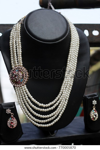 Indian Imitation Jewelry Necklace Display Front Stock Photo