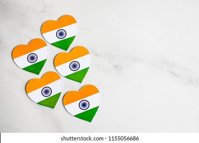 Indian Independence day background with heart shaped decor with indian flag colors. Celebration of Indian independence day, the 15th of August.  Copy space. Love India concept. Indian republic day.